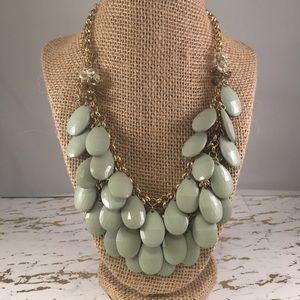 Sage green statement necklace.
